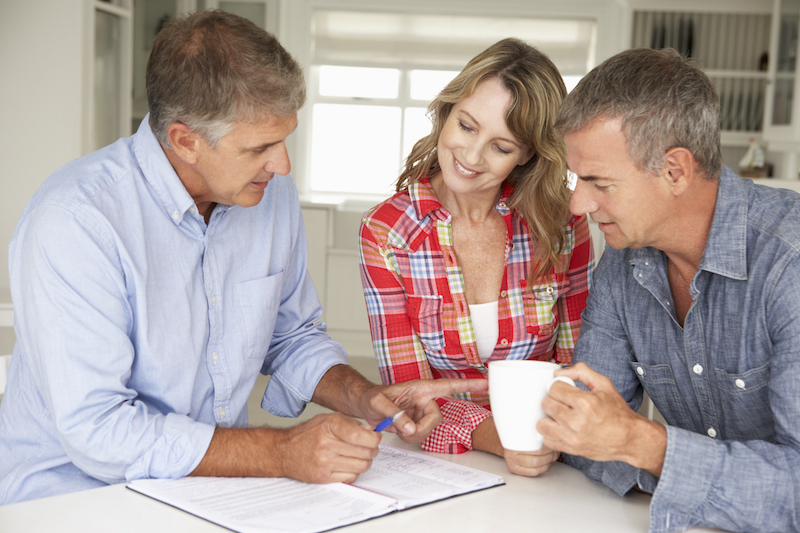 homeowners reviewing load calculation